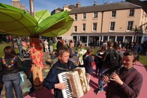 The traffic island in question, which was temporarily converted into a 'tropical island' at a previous community event. Picture courtesy of thecausey.org