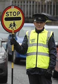 Picture courtesy of http://edinburghnews.scotsman.com/topstories/Lollipop-man-quits-over-ban.5703222.jp