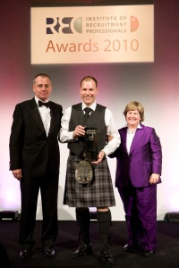 David Tait proudly shows his award