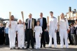 Boris Johnson with torchbearers in new uniforms.