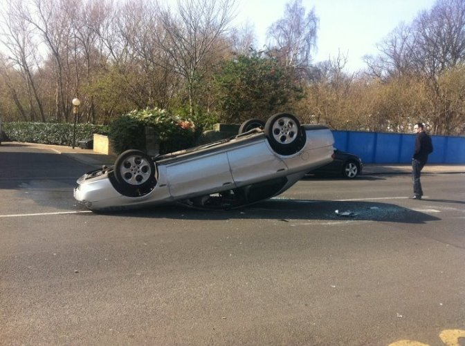 Car crashes outside secondary school