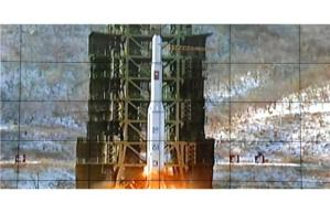 A screen shows the Unha-3 rocket being launched from a launch pad at the West Sea Satellite Launch Site, at North Korea's satellite control centre in Cholsan county (AP)