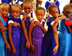 african children waiting for a vaccination